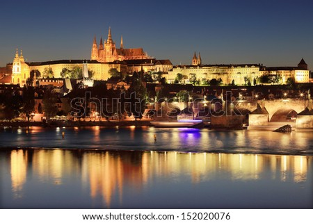 The View on colorful Prague gothic Castle with Charles Bridge in the Night, Czech Republic - stock photo