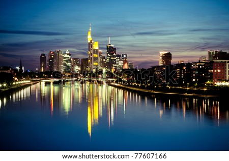 The view on Frankfurt skyline at night with reflection in the water