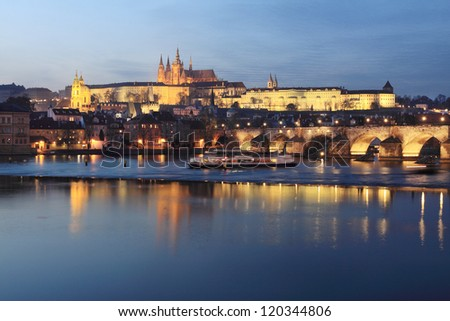 The View on Prague gothic Castle with Charles Bridge past Sunset, Czech Republic - stock photo