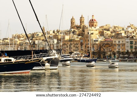 The view on Senglea and yachts in sunset, Malta - stock photo