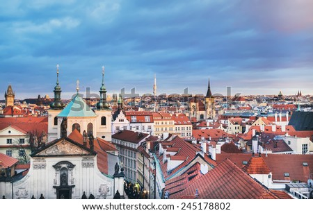 The view over the red roofs of Stare Mesto district in Prague, Czech Republic, from the view point on top of the tower of the Charles bridge in winter - stock photo