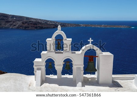 The view with church bells over the village of Oia at the Island Santorini, Greece