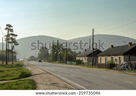 The village Mauke at the sunset in Southern Urals in Chelyabinsk region, Russia - stock photo