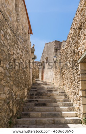 The village Prasies situated south-east of Rethimno. The Venetian style is always tangible in the small town on Crete. Narrow alleys meander through the village Old buildings remember the past