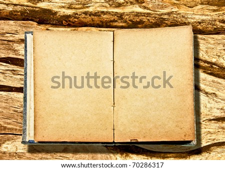 The Vintage blank book  isolated on wood background - stock photo