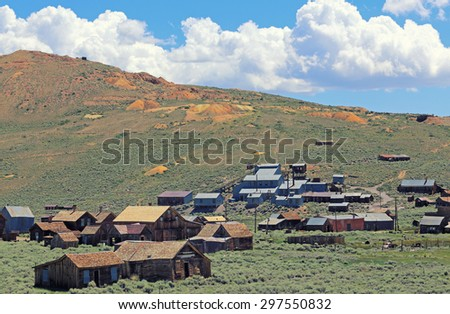 The vintage buildings comprising the Bodie ghost town nestle in the hills east of Yosemite National Park at an elevation above 8,000 feet. - stock photo