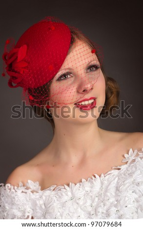 The vintage girl in a hat with a veil - stock photo
