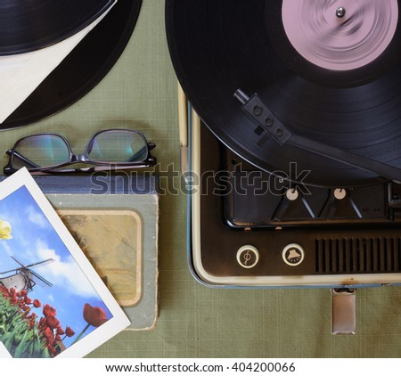 The vintage player of vinyl records retro toning. Flat lay.