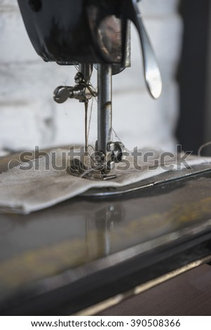 The vintage sewing machine. - stock photo