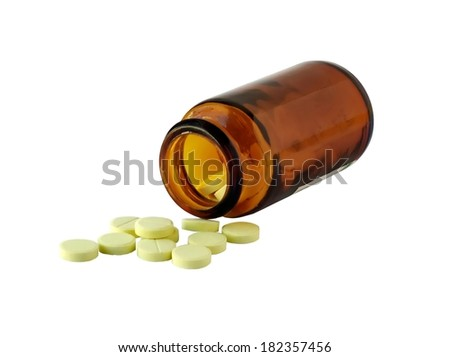The vitamins scattered from a bottle as tablets  - stock photo