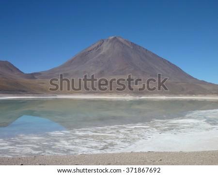 the volcan licancabur at chilean bolivian border - stock photo