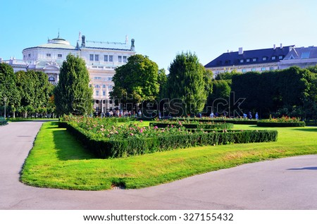 The Volksgarten (People's Garden) is a public park View on the Imperial Court Theater as seen from the People's Garden in Vienna, Austria - stock photo