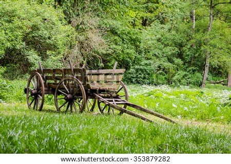 The wagon stands in a clearing.