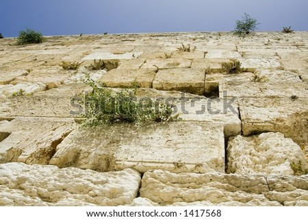 The wailing wall (western wall), Jerusalem, shot from below, with blue skies on top - stock photo