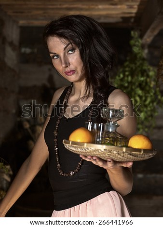 the waitress with tequila and citrus fruits