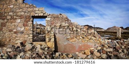 The Wall And Window Of A Crumbling And Ruined Building At Rhyolite Nevada,  An Abandoned