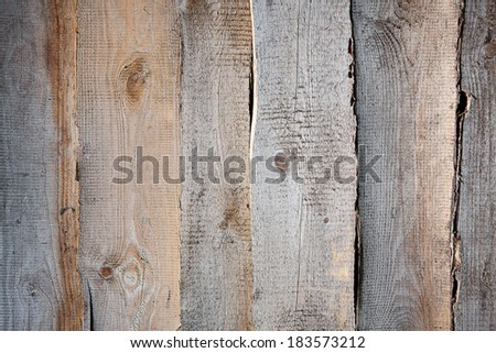 The wall arranged with the old, curved boards. - stock photo