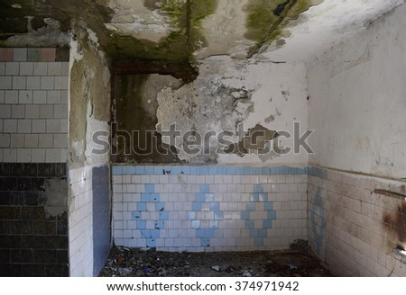 The walls of an old abandoned building. The ruins of the buildings of the twentieth century. - stock photo