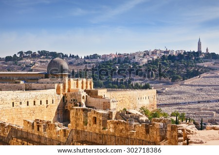 The walls of Jerusalem. In the distance you can see the gray dome of the Al-Aqsa Mosque and the Muslim minaret - stock photo