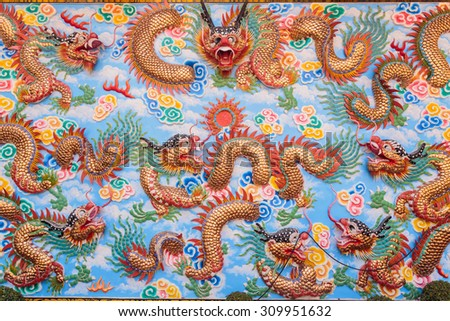 The walls of the temple with a dragon pattern. - stock photo