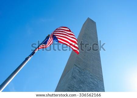 The Washington Monument and an US flag - stock photo