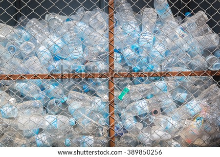 The waste bottles from the garbage put out for recycling in the steel grating. - stock photo