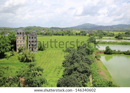 the watchtower and southern china farm landscape in summer cloudy day in kaiping diaolou  unesco world heritage site