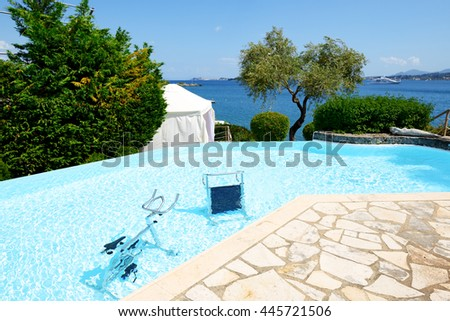 The water bicycle in swimming pool, Corfu, Greece