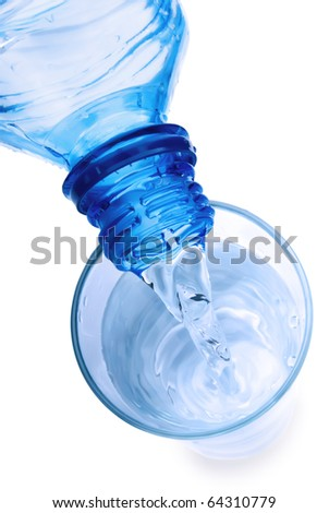 The water flowing in a glass.The top view - stock photo