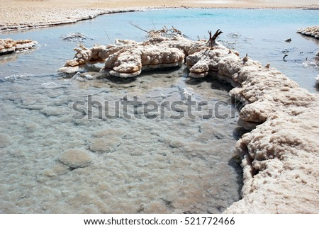 The water of the Dead Sea. Salt crystals on the shore of the Dead Sea. Israel. Salt water evaporates to form beautiful crystals of salt.