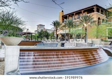The Waterfront District of downtown Scottsdale Arizona looking toward South Bridge from Stetson Drive. - stock photo