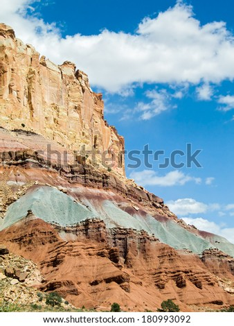 The Waterpocket Fold, a long geological feature running through Utah's Capitol Reef National Park, displays many vivid colors of earth strata. - stock photo