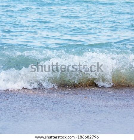 the wave of sea water is moving to the shore - stock photo