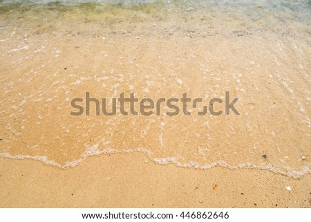 the wave washing ashore, summertime relaxing on the beach, sea and sand background