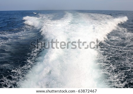 The waves from a high-speed boat - stock photo