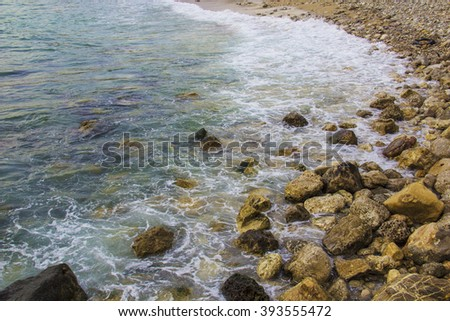 the waves of the sea, sand and rocks
