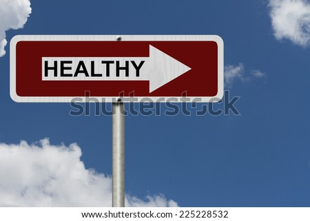 The way to being healthy, Red and white street sign with word Healthy with sky background