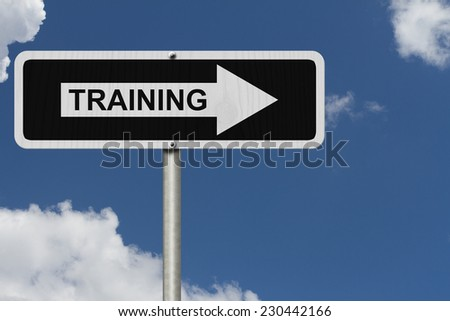 The way to get training, Black and white street sign with word Training with sky background