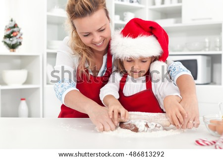 The way we make christmas cookies with mom - little girl and woman in the kitchen