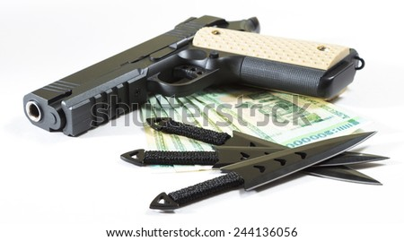 The weapon and money on a white background. The gun, throwing knives and the Belarusian money on a white background. The isolated image.  - stock photo