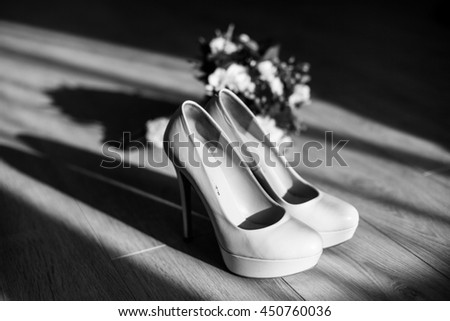 The wedding bouquet stands near shoes - stock photo