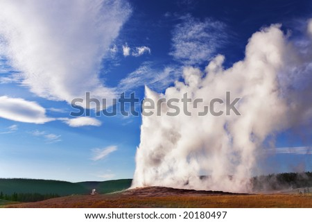 The well-known geyser in Yellowstone national park - Old Faithful. Eruption comes to an end - stock photo