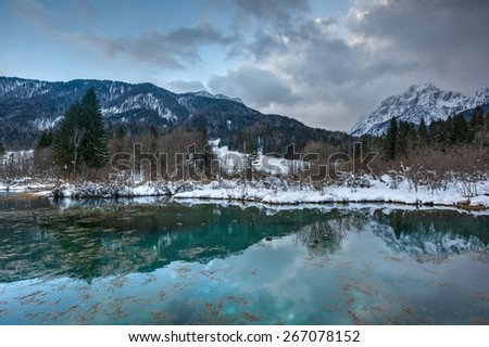 The well on river Sava in Julian Alps - stock photo