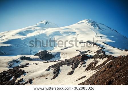 The western and eastern peaks of mount Elbrus closeup - 5642 meters and 5621 meters. Caucasus mountains, Russia - stock photo