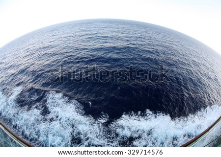 The Western Caribbean Ocean as seen through a 14mm fish eye lens from the deck of a cruise ship. - stock photo