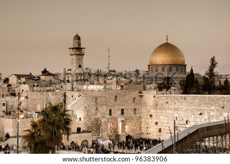 The Western Wall, also known at the Wailing Wall or Kotel, is the remnant of the ancient wall that surrounded the Jewish Temple's courtyard in jerusalem, Israel. - stock photo