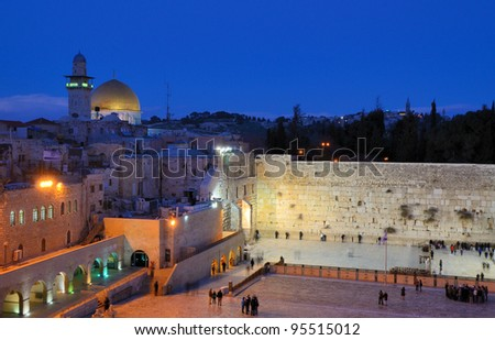 The Western Wall, known at the Wailing Wall or Kotel, is the remnant of the ancient wall that once surrounded the Temple Mount in jerusalem, Israel. The mount is currently home to Dome of the Rock. - stock photo