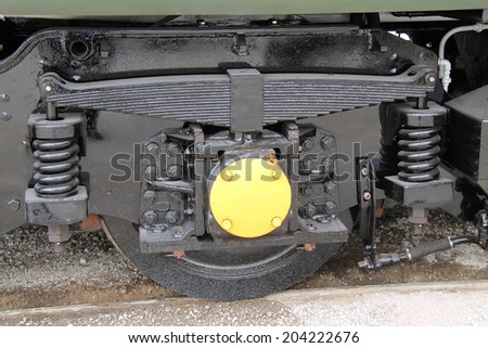 The Wheel and Suspension of a Diesel Train Engine. - stock photo