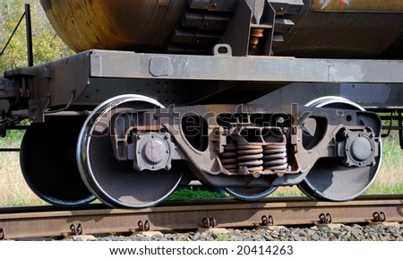 The wheel mechanism of the train with the tank - stock photo