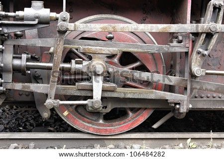 the wheels of an old steam engine - stock photo